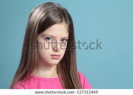 Portrait sad girl on a blue background. - stock photo
