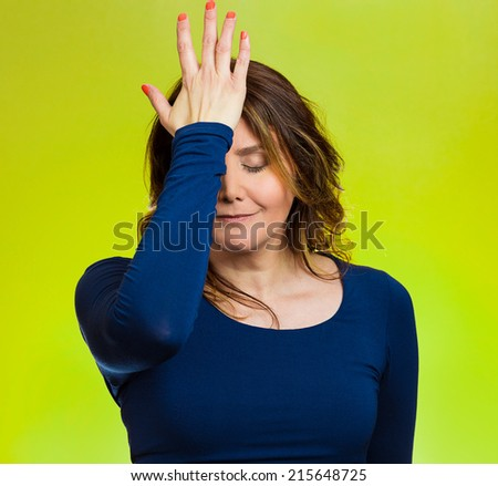 Portrait sad middle aged woman realizes mistake, regrets, slapping hand on head to say duh, isolated green background. Negative emotions, facial expression, feelings, body language, reaction - stock photo