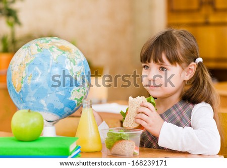 portrait schoolgirl while having lunch during - stock photo