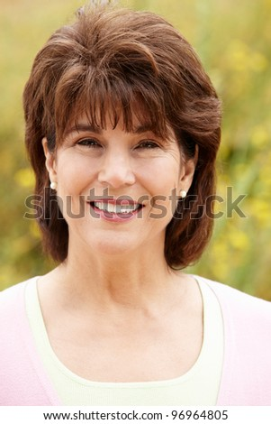 Portrait senior hispanic woman outdoors - stock photo