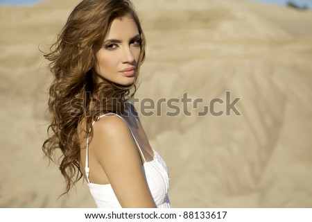 portrait sensuality brunette girl over sand background - stock photo