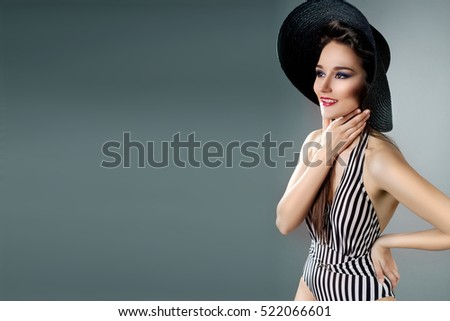 Portrait sexy beautiful brunette hair woman Posing in bikini, hat and  sunglasses. Travel lifestyle.