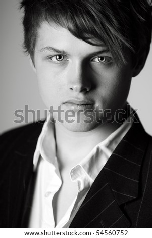 Portrait Shot of a Handsome Teenage Boy in Suit and Shirt - stock photo