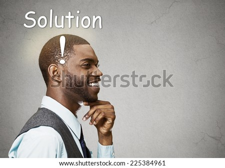 Portrait side view profile headshot happy man thinking found solution for problem isolated grey wall background with copy space. Human face expression emotion feeling body language perception iq - stock photo