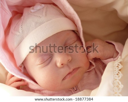 portrait sleeping newborn baby girl in knitted bonnet, wrapped soft blanket - stock photo