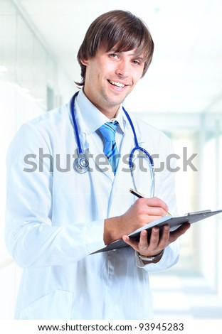 Portrait smiling doctor at office - stock photo