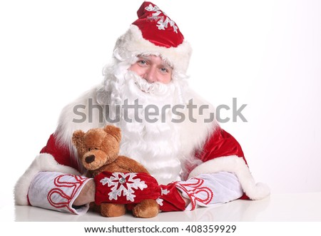 Portrait smiling Father Frost holding a teddy bear