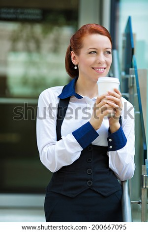 Portrait smiling lawyer businesswoman corporate professional walking outdoors holding, drinking coffee from disposable paper cup. Happy hispanic business woman on lunch break. Positive face expression - stock photo