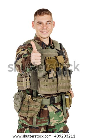 Portrait soldier or private military contractor gesturing thumbs up. war, army, weapon, technology and people concept. Image on a black background. - stock photo