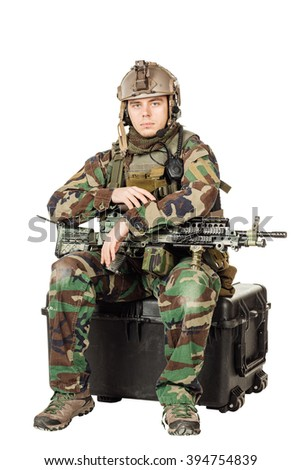 Portrait soldier or private military contractor holding with a machine gun and holding a box. war, army, weapon, technology and people concept. Image on a white background - stock photo