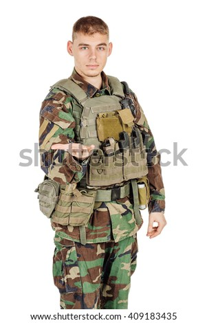 Portrait soldier or private military contractor showing his hand. war, army, weapon, technology and people concept. Image on a black background. - stock photo