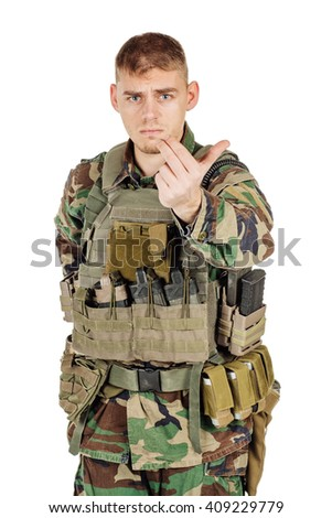 Portrait soldier or private military contractor with inviting or follow me gesture. war, army, weapon, technology and people concept. Image on a black background. - stock photo