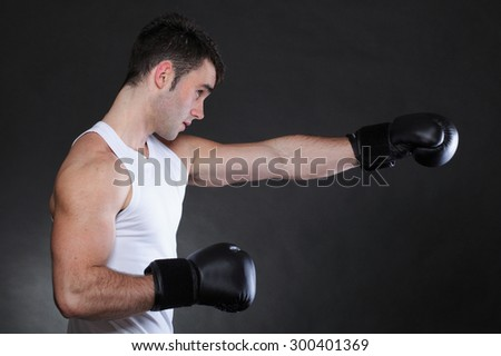 Portrait sportsman boxer in studio against dark background - stock photo