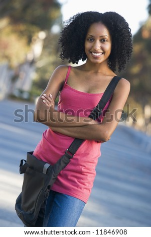 Portrait standing outside on campus - stock photo