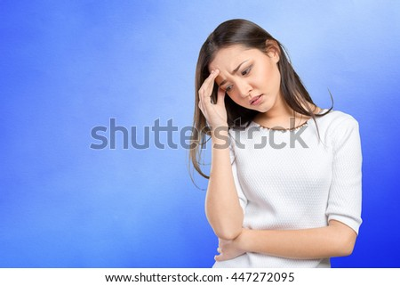 Portrait stressed sad young woman standing - stock photo