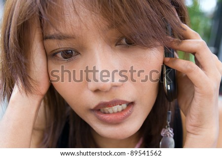 Portrait stressed woman with cellular telephone