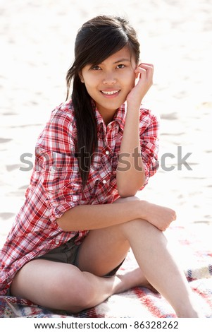 Portrait teenage girl on beach