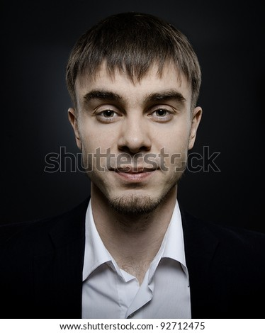 portrait  the  beautiful  businessman careerist in black costume without necktie