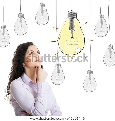 Portrait thinking beautiful italian woman looking up with idea light bulb above head isolated on white background