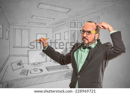 Portrait thoughtful middle aged man graphic designer drawing with pen pencil sketch of future apartment. Architecture home renovation remodeling concept isolated grey wall background. Face expression - stock photo
