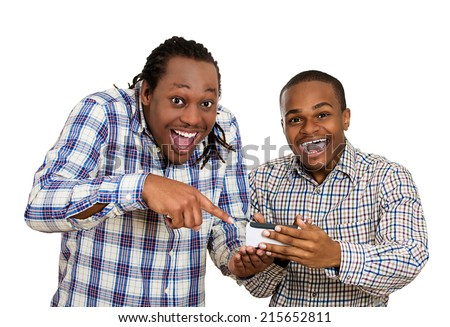 Portrait two men looking excited with opened mouth on cell phone watching football game, reading sms, e-mail viewing latest news, isolated white background. Positive human emotions, facial expressions