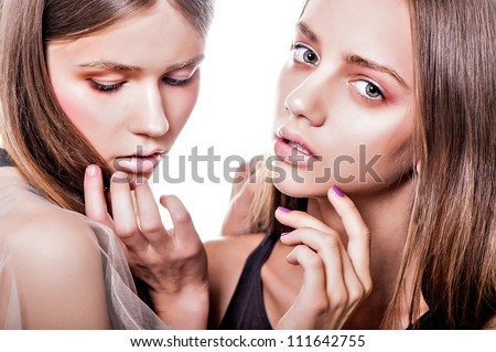 portrait two  women fashion model posing on isolated background - stock photo