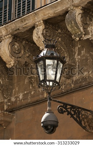 portrait up close to a street lamp - stock photo