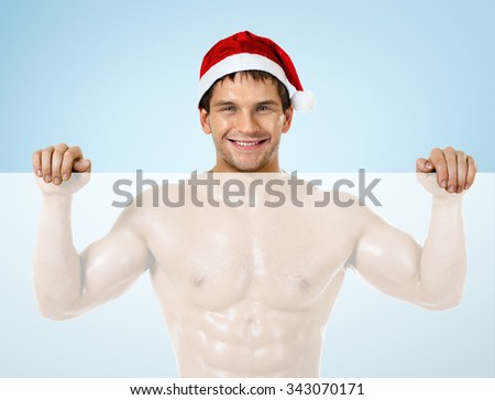 portrait very muscular  bronzed handsome sexy Santa Claus , stand and smile - stock photo