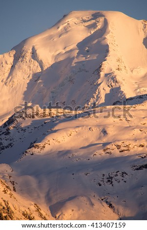 Portrait view of a close up of sunset on the North face of Petit Combin in Valais,Switzerland