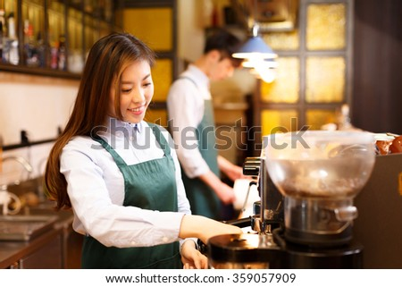 portrait waitress and waiter serving in cafe - stock photo