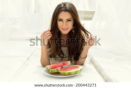 Portrait with a sexy girl with watermelon - stock photo