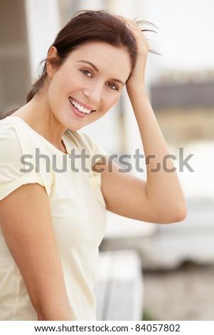 Portrait woman sitting outdoors - stock photo