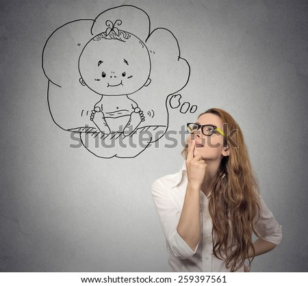 Portrait woman thinking dreaming of a child - stock photo