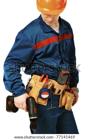 Portrait work man in work wear with instrument and drill against white - stock photo