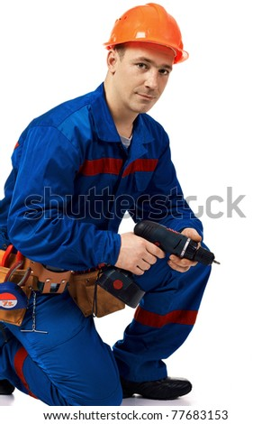 Portrait work man in workwear with instrument and drill against white - stock photo