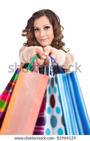 portrait young adult girl with colored bags,  isolated on white background - stock photo