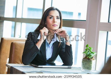 Portrait young attractive businesswoman thinking. - stock photo