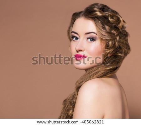 Portrait young beautiful blond woman with long hairdress