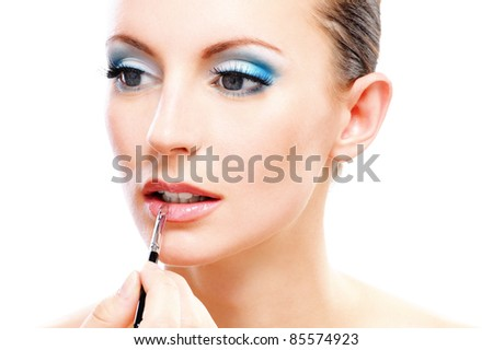 Portrait young beautiful dark-haired woman close up with which paint lips, isolated on white background. - stock photo