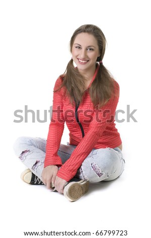Portrait  young beautiful happy girls sitting on the floor on a white background