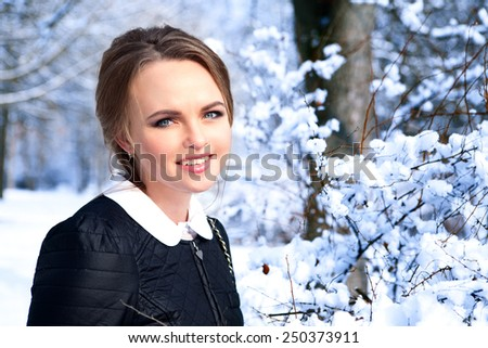 Portrait  young beautiful laughing girl in winter - close up. - stock photo