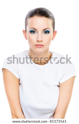 Portrait young beautiful serious dark-haired woman in white T-shirt, isolated on white background. - stock photo