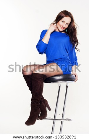 Portrait ? young beautiful woman sitting on chair - stock photo