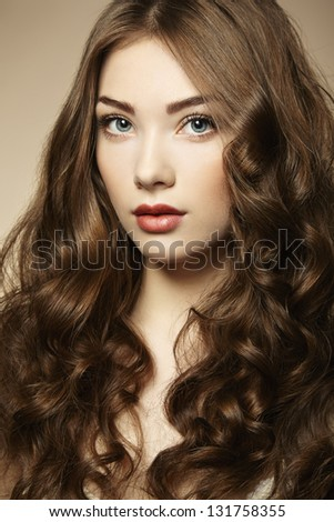 Portrait young beautiful woman with curly hair. Fashion photo - stock photo
