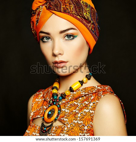 Portrait young beautiful woman with necklace. Fashion photo - stock photo
