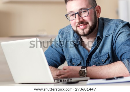 Portrait young businessman in his office - stock photo