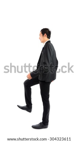 Portrait young businessman walking isolate on over white background