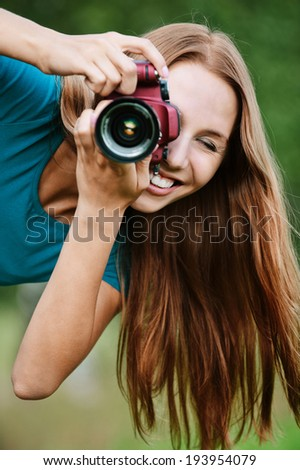portrait young charming long-haired woman leaned photographs - stock photo