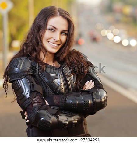 portrait young charming long-haired woman standing leather suit - stock photo