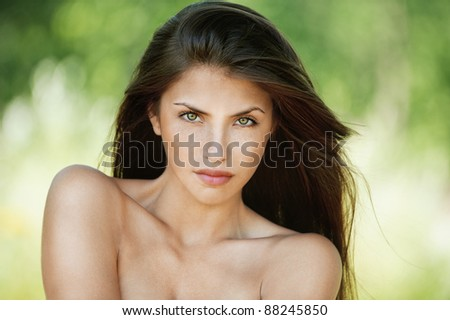portrait young charming woman romantic sexy stripped serious background summer green park - stock photo